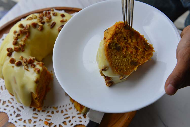 A Slice Of Spiced Carrot Cake With Orange Cream Cheese Icing